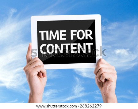 Tablet pc with text Time For Content with sky background - stock photo