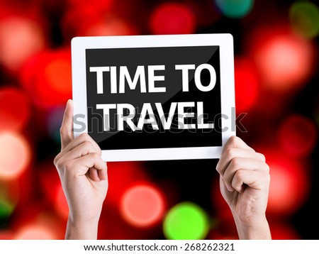Tablet pc with text Time To Travel with bokeh background - stock photo