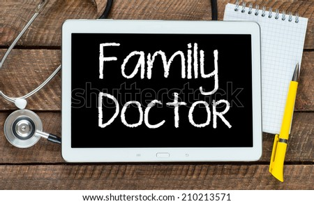 Tablet pc with word Family doctor and stethoscope, medicine concept - stock photo