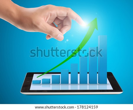 Tablet screen with graph and a hand - stock photo