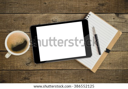 tablet similar to ipades style on wood desk on top view - stock photo