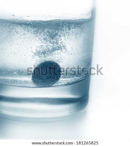 Tablet sinking in water close-up - stock photo