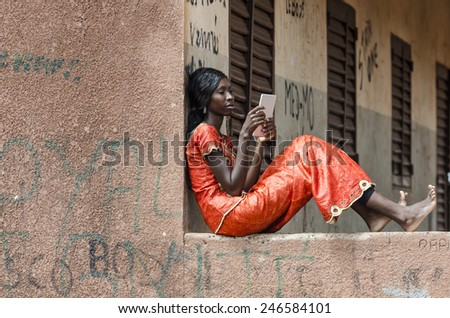 Tablet Technology: African Ethnicity Girl Studying For Exam in Mali  - stock photo