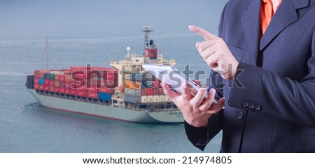 tablet to handle export and A container ship arriving in port . - stock photo