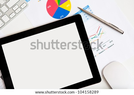 tablet touch pad computer gadget on the desk of a businessman - stock photo