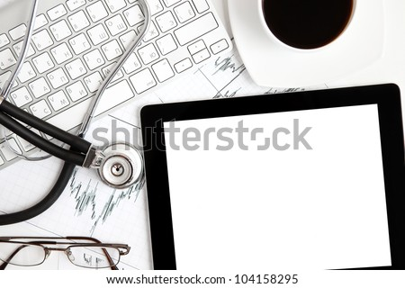 tablet touch pad computer gadget on the table at the doctor - stock photo