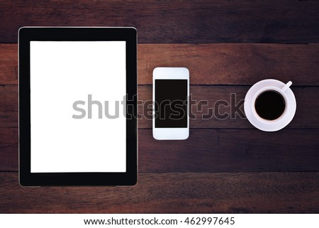 tablet white screen display and coffee on wood table.