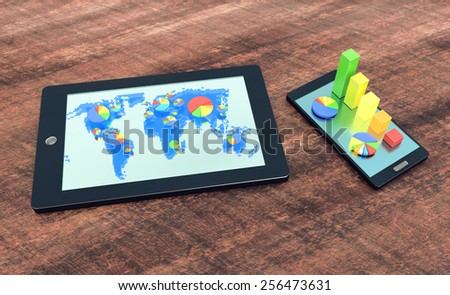 Tablet with blue holograph world map and circle diagrams and smartphone with bar graph on wooden office desk - stock photo