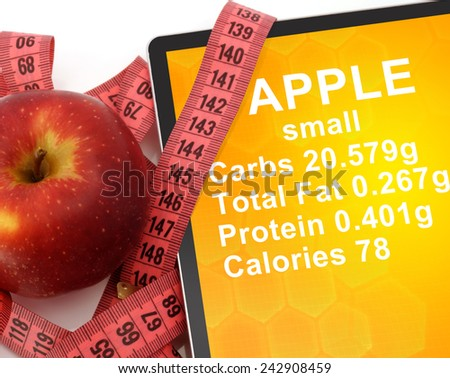 Tablet with Calories In Apple  and measuring tape on white background. nutrition facts - stock photo
