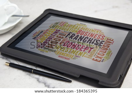 tablet with Franchise word cloud - stock photo