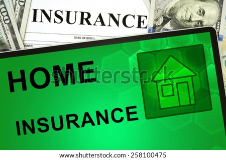 Tablet with Home insurance  online and money.  - stock photo