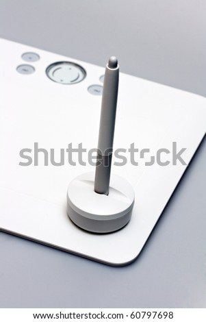 tablet with pen on gray - stock photo
