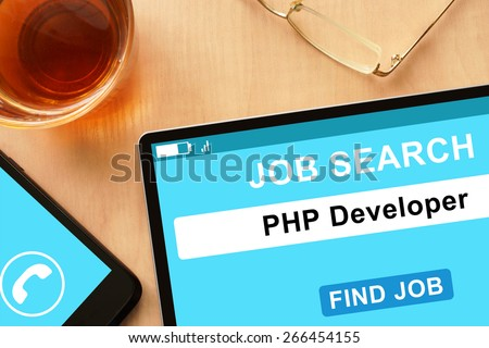 Tablet with PHP Developer  on  job search site. - stock photo