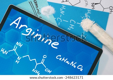 Tablet with the chemical formula of Arginine  - stock photo