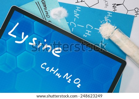 Tablet with the chemical formula of  Lysine  - stock photo