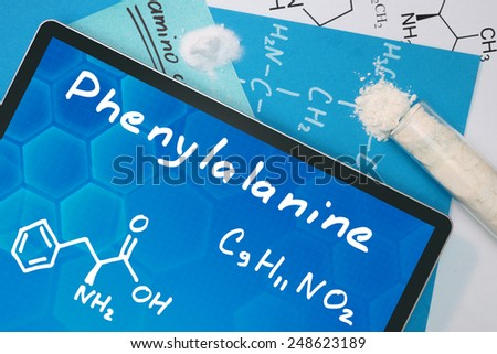 Tablet with the chemical formula of Phenylalanine - stock photo