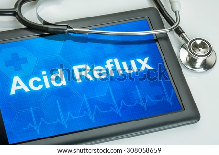 Tablet with the diagnosis Acid Reflux on the display - stock photo