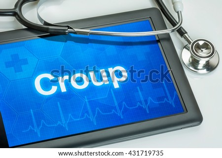 Tablet with the diagnosis Croup on the display - stock photo