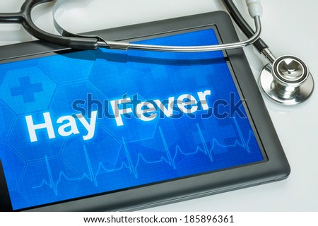 Tablet with the diagnosis hay fever on the display - stock photo