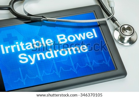 Tablet with the diagnosis Irritable bowel syndrome on the display - stock photo