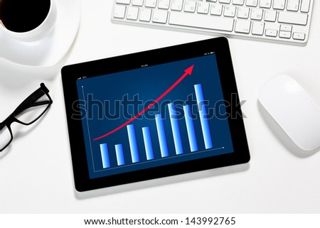 tablet with the schedule on the screen is in the office of a businessman on the table - stock photo
