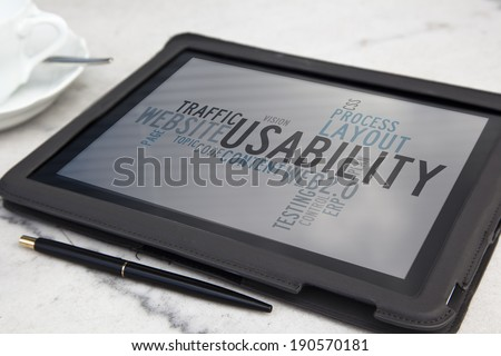 tablet with usability software word cloud - stock photo