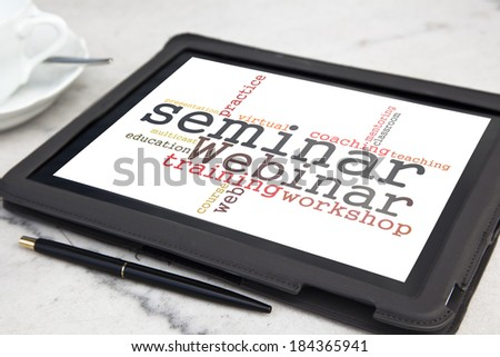 tablet with webinar word cloud - stock photo