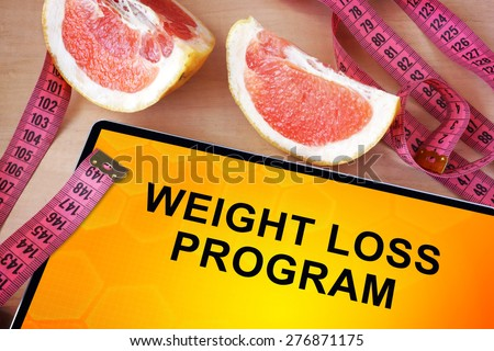 Tablet with weight loss program. Weight loss concept.  - stock photo