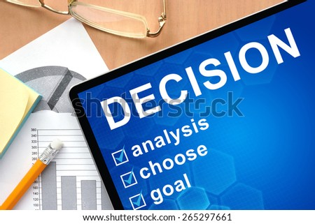 Tablet with word decision . Business and management concept. - stock photo