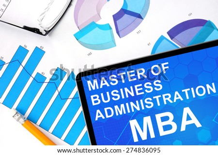 Tablet with word  MBA - Master of Business Administration and graphs. Concept photo. - stock photo