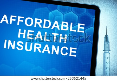 Tablet with words  affordable health insurance and syringe - stock photo