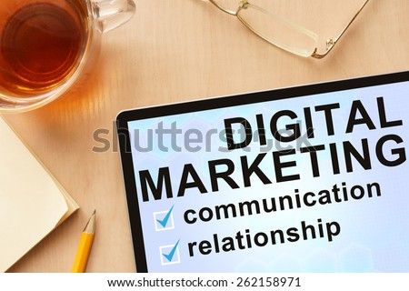 Tablet with words digital marketing. Business concept. - stock photo