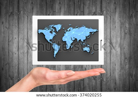 Tablet with world map - stock photo