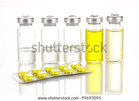 Tablets and ampoules isolated on white