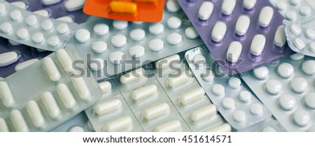 Tablets and capsules in blisters. Pharmaceutical texture