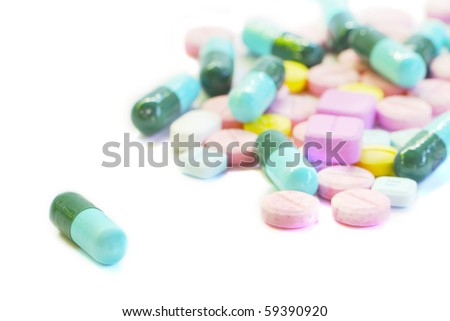 Tablets And capsules isolated - stock photo