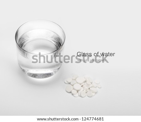 tablets and pills and glass of water - stock photo