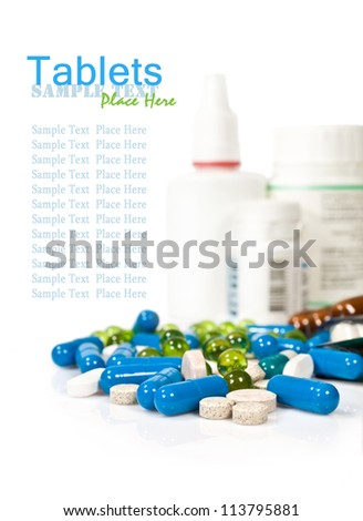 tablets and pills on a white background - stock photo
