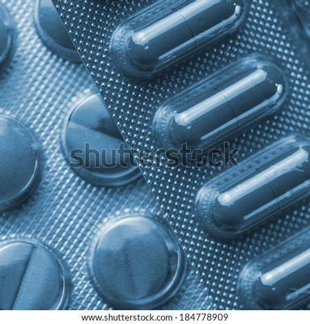 Tablets heap in a Blister packaging antibiotic flu pharmacy medicine medical - stock photo