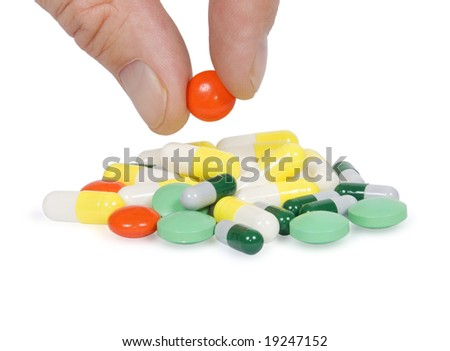 Tablets in a hand isolated on a white background