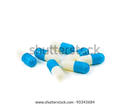 Tablets in capsule form. Isolated on white background - stock photo