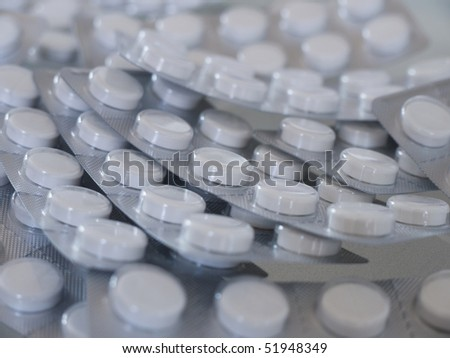 Tablets in push-through strips - stock photo