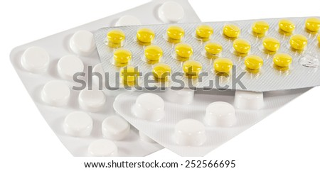 Tablets in the package on a white background - stock photo