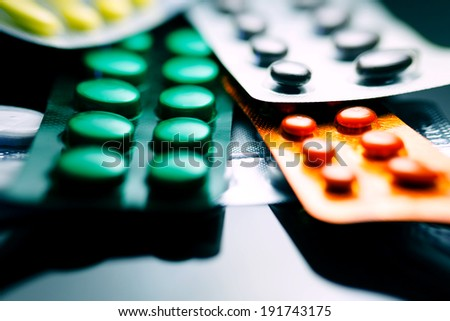 Tablets. Medicine symbol. Small depth of field. Pincushion lens use. - stock photo