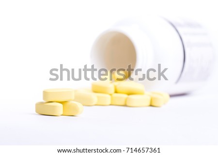 Tablets poured from a jar