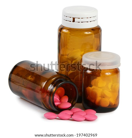Tablets to a glass jar  on white - stock photo