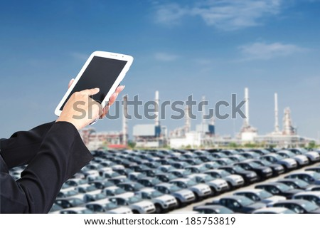 Tablets to deal with export and import vehicles. - stock photo