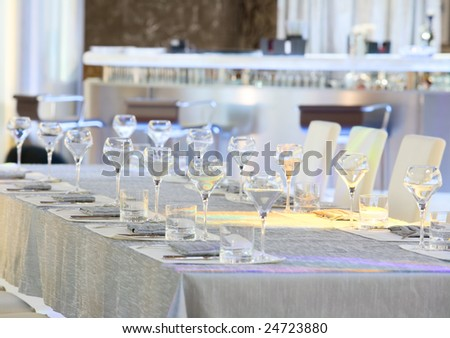 Tableware and glasses on a table - stock photo