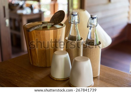 tableware and kitchenware concept - couple of bottles and glasses on table at hotel room - stock photo