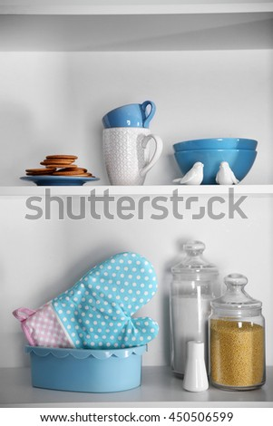Tableware and kitchenware on a shelves - stock photo